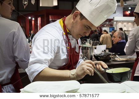 Young Cook Works On His Recipe At Homi, Home International Show In Milan, Italy