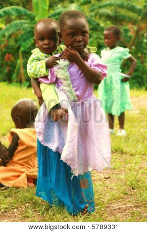 Poor Children from Uganda Africa dressed in colorful dresses for church
