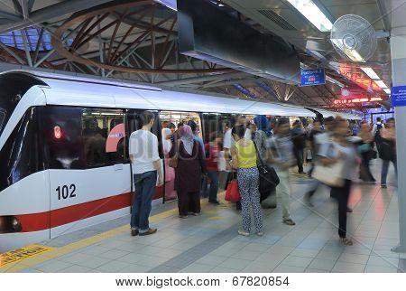 Commuters at LRT station Kuala Lumpur Malaysia