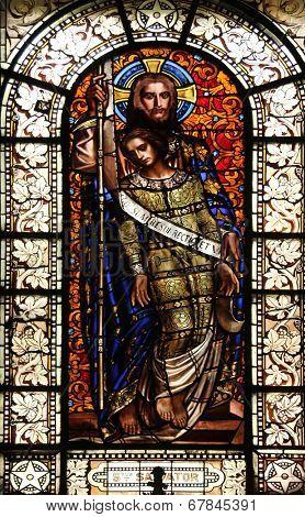 PARIS, FRANCE - NOV 10, 2012: Savior, stained glass, Saint-Vincent-de-Paul Church (design Jean-Baptiste Lepere, was built during 1824 - 1844) dedicated to Saint Vincent de Paul