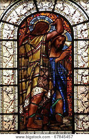 PARIS, FRANCE - NOV 10, 2012: Baptism of the Lord, stained glass, Saint-Vincent-de-Paul Church (design Jean-Baptiste Lepere, was built during 1824 - 1844) dedicated to Saint Vincent de Paul
