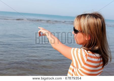 Young Woman Standing By The Sea
