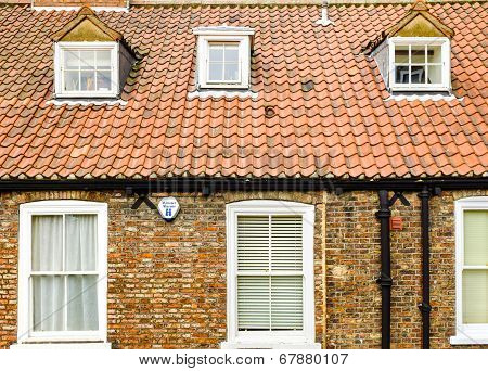 A house front roof tiles and dormer windows