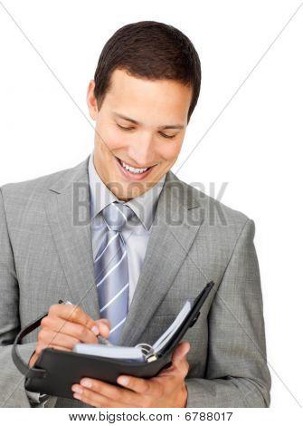 Confident Businessman Holding An Agenda