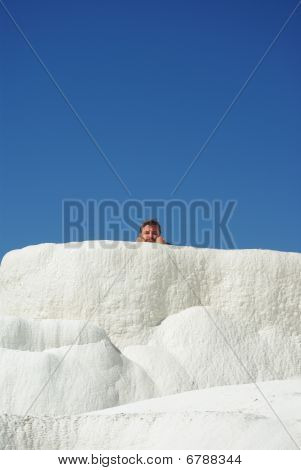 Limestone Of Pamukkale With Tourist Appearing From Behind