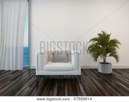 Armchair and potted palm on a wooden parquet floor alongside a curtained window with a view of the sea in a living room interior