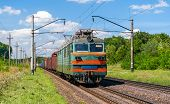 Electric locomotive hauling a cargo train in Ukraine poster