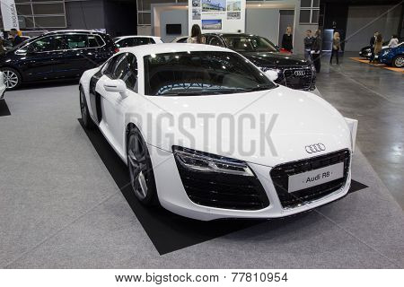VALENCIA, SPAIN - DECEMBER 4, 2014: A white 2015 Audi R8 sports car at the Valencia Automovil 2014 Car Show. The Audi R8 was introduced by the German automaker Audi AG in 2006.