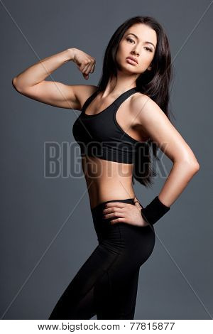 Athletic girl in sport clothes