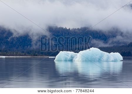 Diminishing glacier melts in waters created by climate change's effects on Mendenhall Glacier Juneau Alaska. poster
