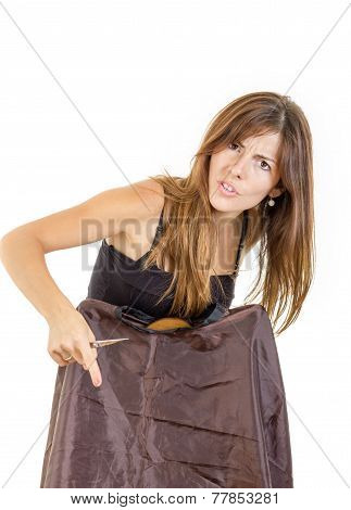 Young pretty angry and disappointed female hairdresser with comb and scissors waiting impatiently for customer isolated on white background. Concept of insufficient work in profession while seeking job poster