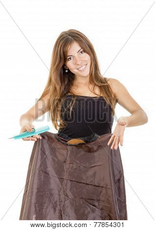 Young pretty smiling female hairdresser with comb and scissors waiting impatiently for customer isolated on white background calling you or someone. Concept of great work in profession and enjoying job poster