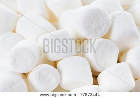 White Fluffy Round Marshmallows As A Background. Sweet  Food Candy Background As Poster.