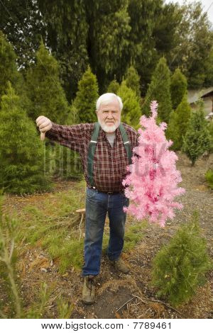 Lumberjack With Pink Christmas Tree With Thumbs Down