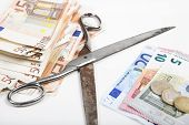 the scissors between poverty and wealth goes further apart illustrated with euros poster