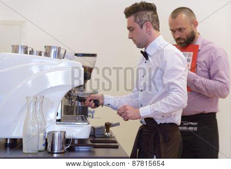 DNEPROPETROVSK, UKRAINE - MAY 30, 2013: Barista Artem Molchan make coffee during 5th Ukrainian Latte Art Championship in Dnepropetrovsk, Ukraine on May 30, 2013