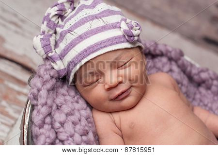 Smiling Baby Girl Wearing A Sleeping Cap