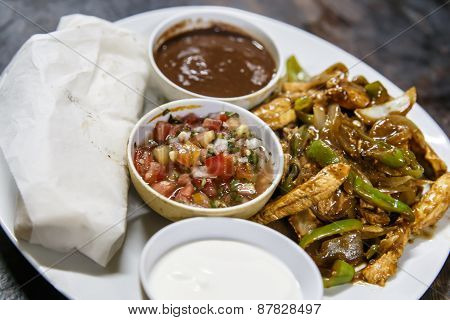 Mexican Dish With Salad And Frijoles Bowl