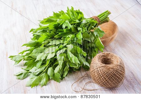 Lovage Leaves On A Wooden Table