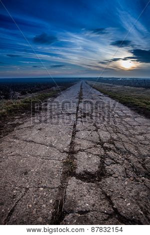Damaged Road In Rural Countyside With Beautifull Sunset