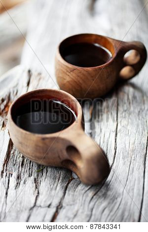 Coffee served from kuksa, finnish wooden cup