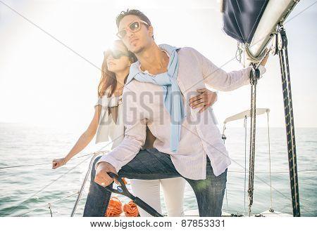 Couple Sailing On Boat