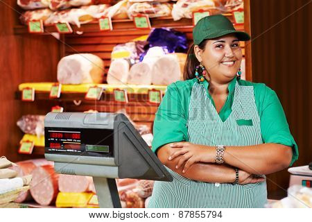 Portrait of sales person worker or assistant seller in supermarket store shop