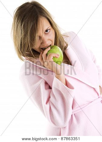Woman In Housecoat With Apple
