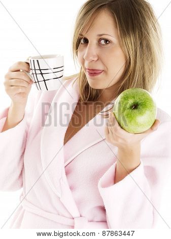 Woman In Housecoat With Coffee And Apple