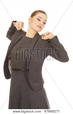 Beautiful businesswoman stretching her back.