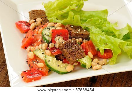 Vegetable Salad With White Beans, Rye Toasts, Tomatoes, Cucumber, Black Sesame Seeds And Letuce In S