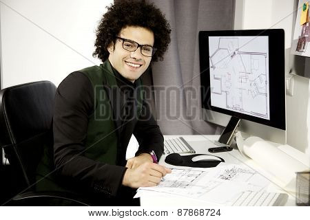 Happy Architect At Work In Office Smiling