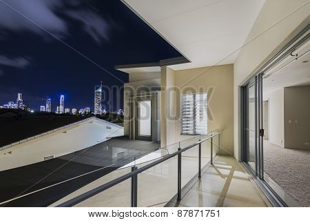 Balcony Exterior Of Mansion With Night Views Of Skyline