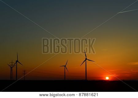 Wind turbines in the sunset