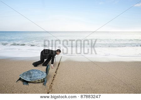 Businessman And Turtle Are Ready To Race On Sand Beach