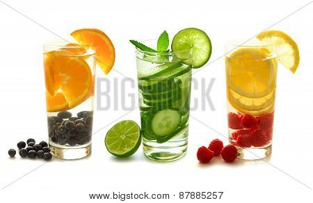 Detox water with fruit isolated on white