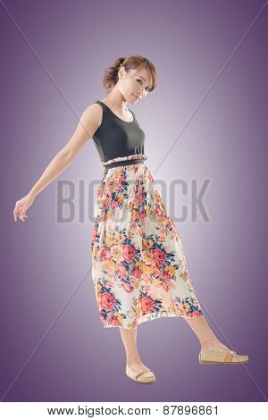 Attractive Asian woman with maxi dresses, full length isolated. poster