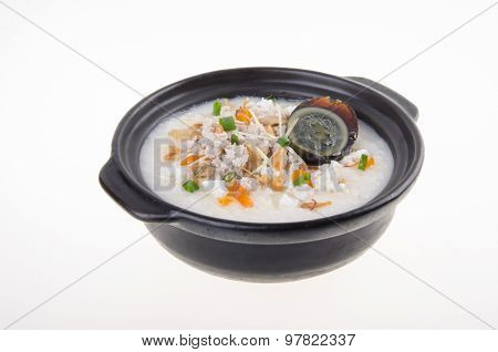 Traditional Chinese Century Egg & Pork Porridge Rice Gruel Served In Claypot