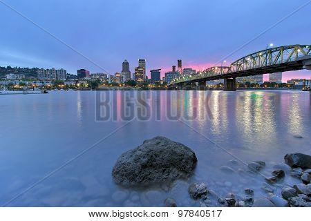 Portland Skyline Along Willamette River At Dusk