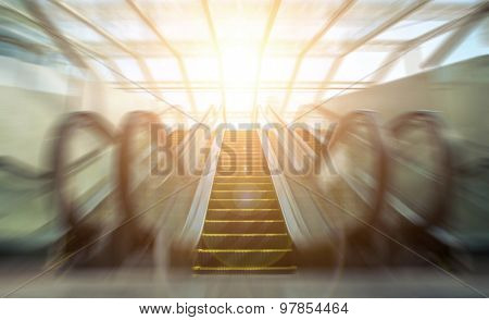 Blurry modern escalator at sunny day. poster