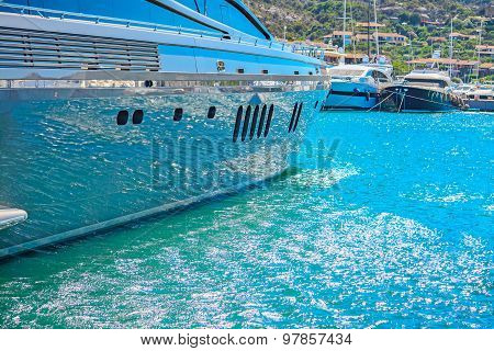 Water Reflected On A Yacht Hull In Porto Cervo Harbor