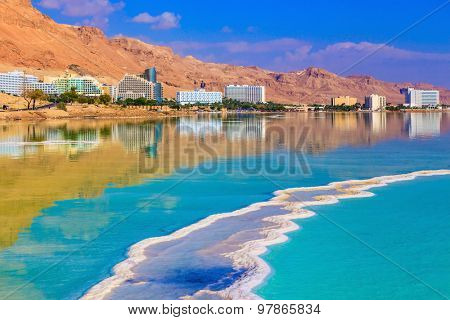The evaporated salt acts over a water surface beautiful patterns. Decrease in water level in the Dead Sea