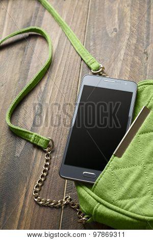 Mobile Phone And Green Handbag