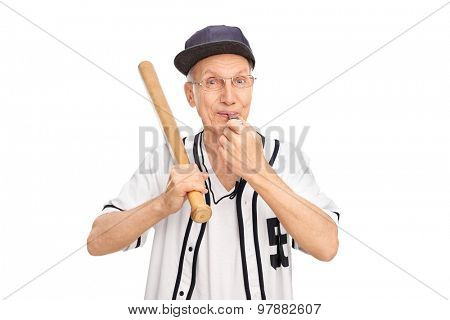 Studio shot of a cheerful senior holding baseball bat and blowing a whistle isolated on white background