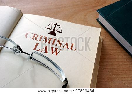 Notepad with words criminal law.