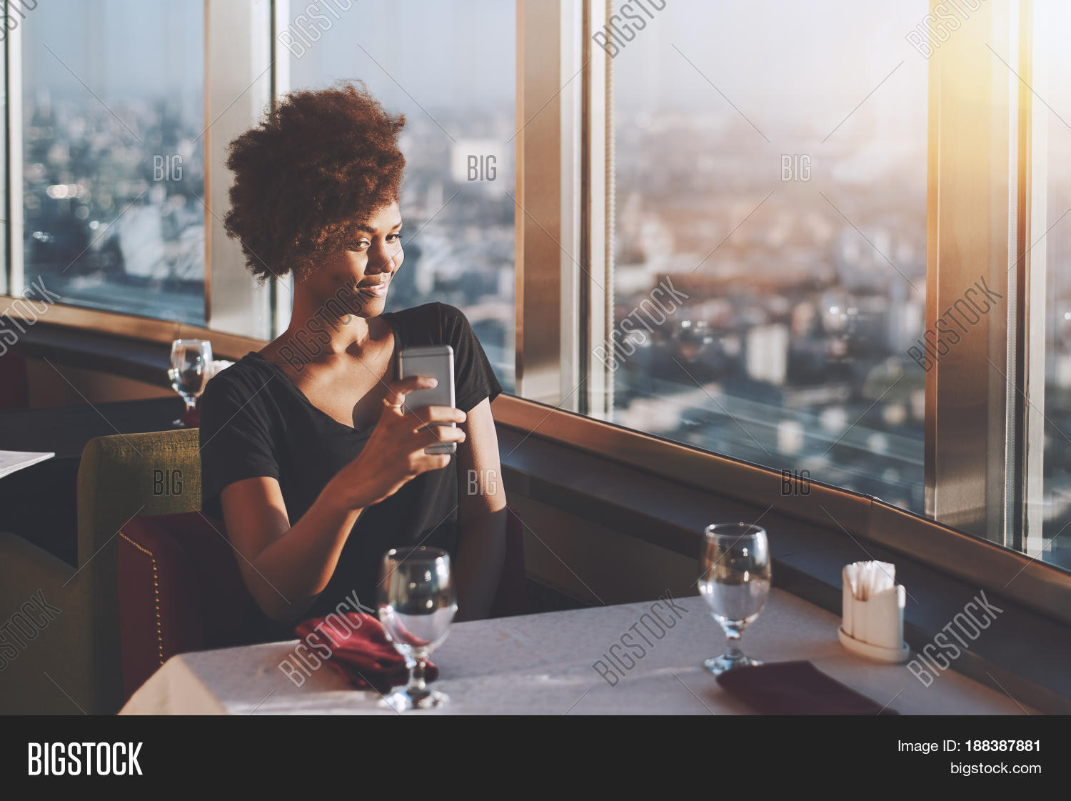 Naughty Curly Afro American Girl Is Sitting In Luxury Cafe On The Top Of Modern Skyscraper