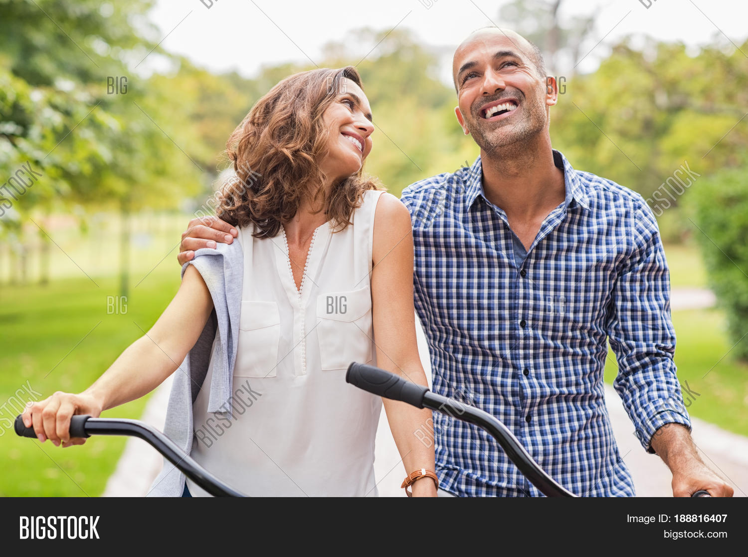 active mature couple riding bikes image & photo | bigstock