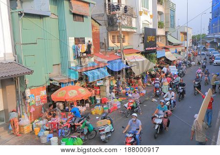 HO CHI MINH CITY VIETNAM - NOVEMBER 28, 2016: Unidentified people ride motorbikes in downtown Ho Chi Minh city.