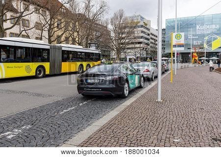 STUTTGART GERMANY - MARCH 01 2017: Modern and environmentally friendly taxi cars - Tesla Model S. Stuttgart is the capital and the largest city of the state of Baden-Wuerttemberg.