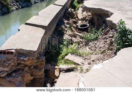Irrigation ditch demolished by the water step and the force of the nature